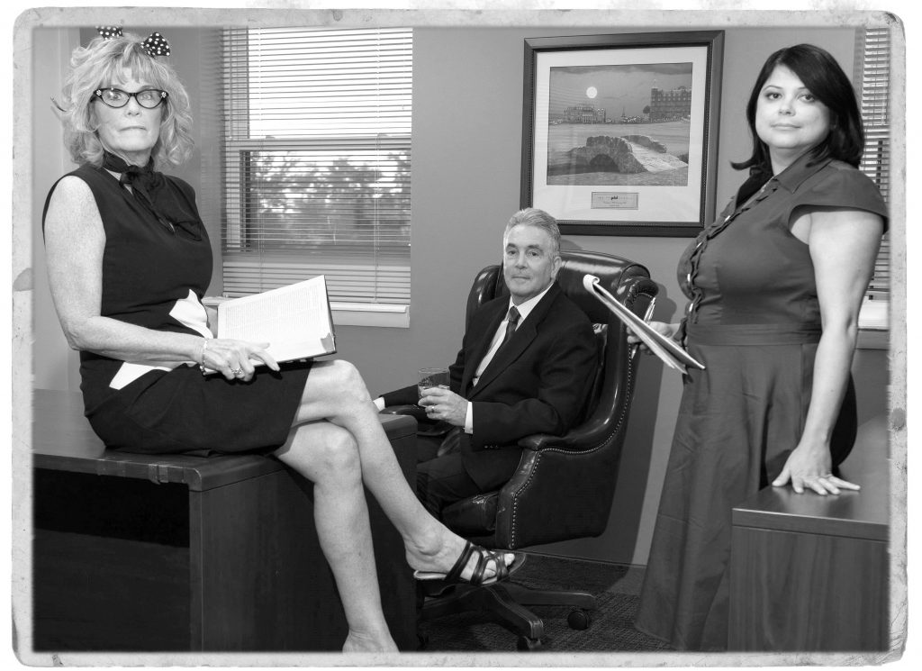 Hanson and Ryan team in an office in black and white