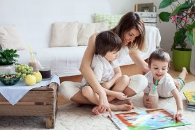 Mother playing board game with two children