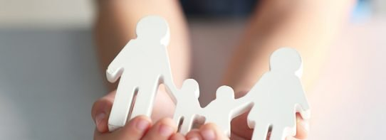 Life Insurance 101 person holding paper family cutouts in hands
