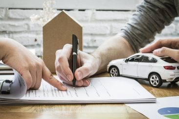 insurance agent signing car insurance policy