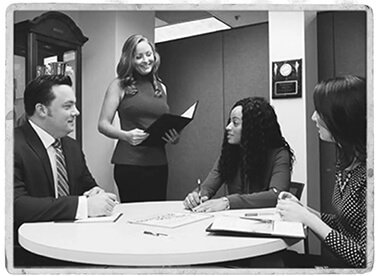 Group in office in black and white